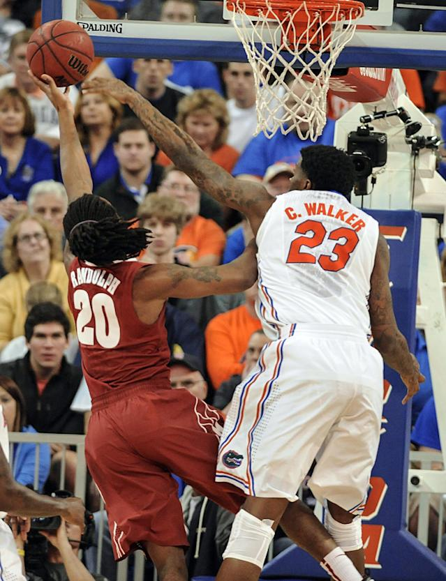 Florida's Chris Walker (23) tries to blocks shot by Alabama guard Levi Randolph (20) but fails during the first half of an NCAA college basketball game Saturday, Feb. 8, 2014, in Gainesville, Fla.(AP Photo/Phil Sandlin)