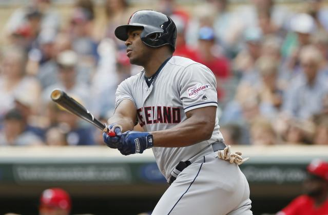Cleveland Indians' Yasiel Puig hits an RBI double off Minnesota Twins pitcher Jose Berrios in the first inning of a baseball game Sunday, Aug. 11, 2019, in Minneapolis. (AP Photo/Jim Mone)