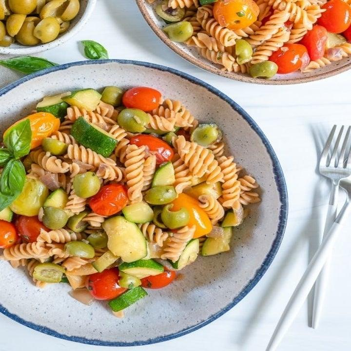 A plate of pasta and colorful veggies