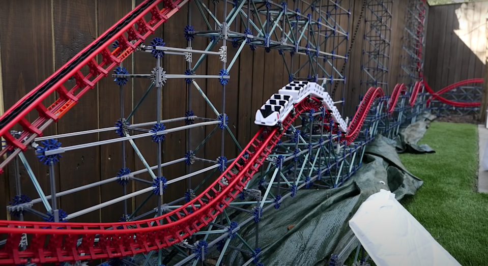Model maker, CoasterWriter, has built a ten-foot-tall backyard-sized K'nex roller coaster, and the mini ride is endless fun to watch.