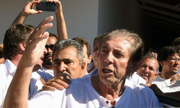 "<span class=""element-image__caption"">João Teixeira de Faria is escorted by supporters upon arriving at the the Dom Inácio de Loyola house in Abadiânia. A spokesman for De Faria, said he denied the accusations.</span> <span class=""element-image__credit"">Photograph: Evaristo Sa/AFP/Getty Images</span>"