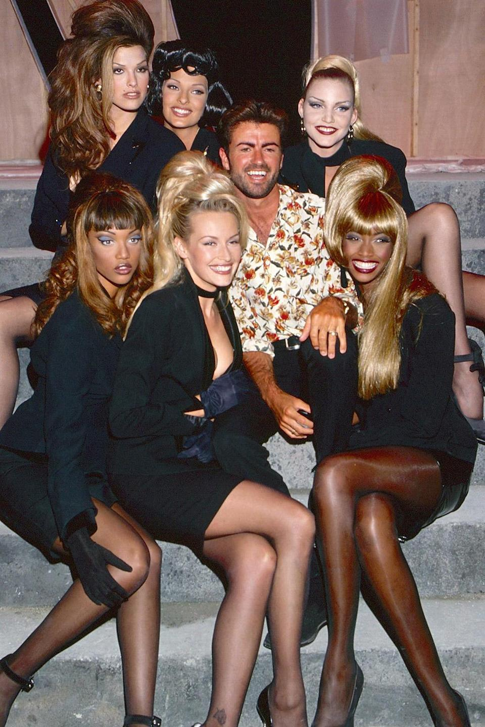 """<p>Hanging with George Michael and a bevy of beauties for the """"Too Funky"""" video shooot in Paris in 1992.</p>"""