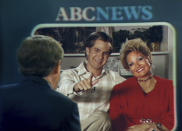 """This image released by Searhlight Pictures shows Andrew Garfield as Jim Bakker, center, and Jessica Chastain as Tammy Faye Bakker in a scene from """"The Eyes of Tammy Faye."""" (Searchlight Pictures via AP)"""
