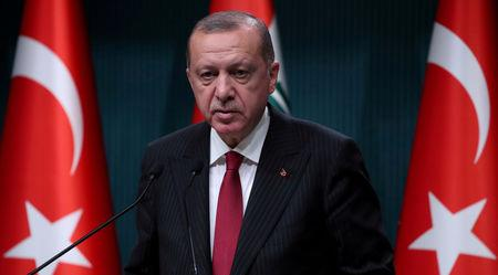 FILE PHOTO: Turkish President Tayyip Erdogan attends a news conference in Ankara