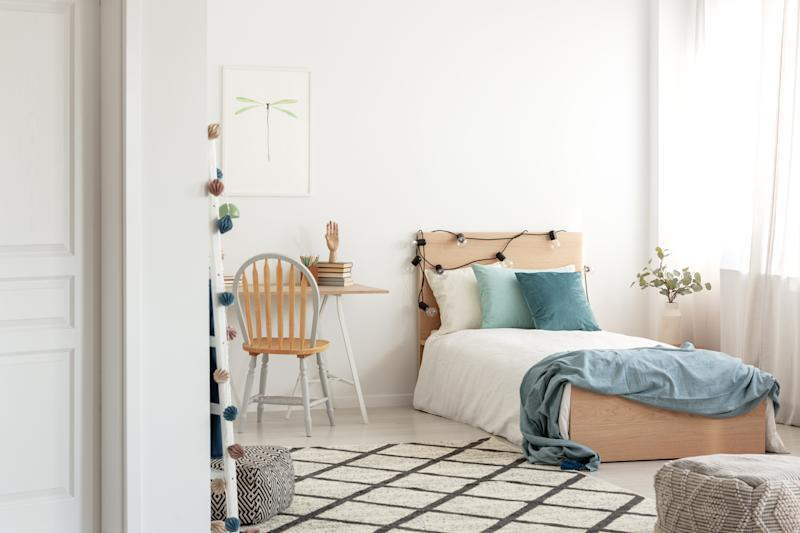 White and wood scandinavian kid's room with comfortable single bed and workspace with desk and chair