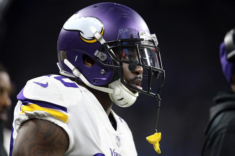 A side view of Mackensie Alexander looking ahead while wearing a Vikings helmet.