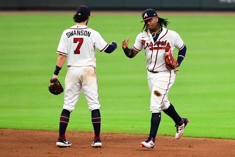 Ronald Acuna Jr. #13 celebrates with Dansby Swanson #7 of the Atlanta Braves after beating the New York Mets at Truist Park on August 01, 2020 in Atlanta, Georgia. (Photo by Scott Cunningham/Getty Images)