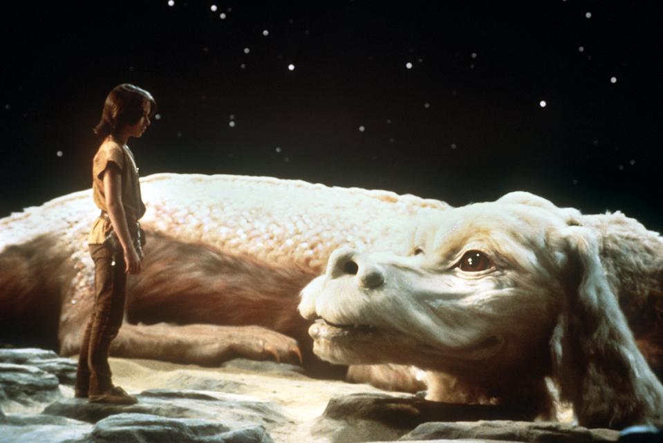 "Noah Hathaway as ""Atreju"" with the white dragon in a scene of the film ""The neverending story"" from 1983. (Photo by dpa/picture alliance via Getty Images)"