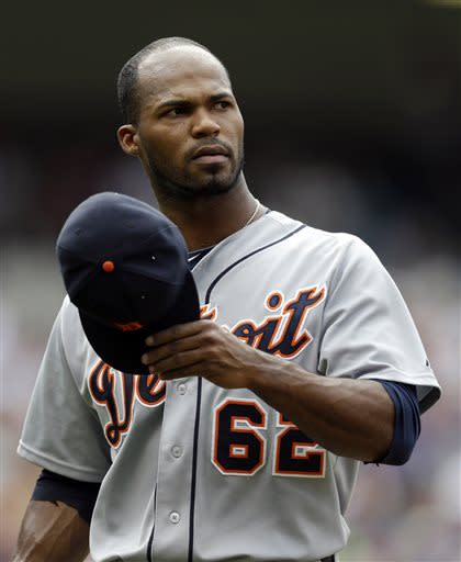 Detroit Tigers relief pitcher Al Alburquerque walks off the field in the eighth inning of a baseball game against the Cleveland Indians, Sunday, July 7, 2013, in Cleveland. The Indians won 9-6. (AP Photo/Tony Dejak)