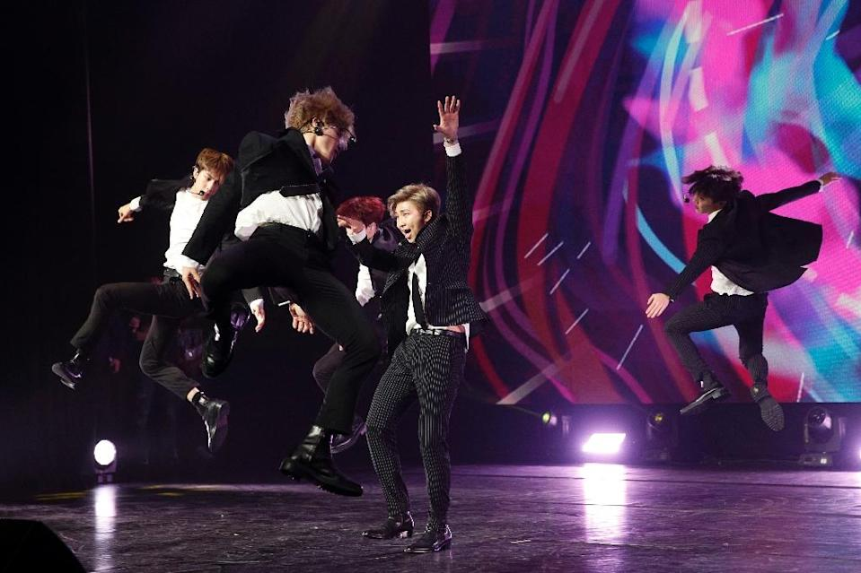Known for their boyish good looks, floppy haircuts and meticulously choreographed dance moves, BTS have become one of South Korea's most valuable musical exports (AFP Photo/YOAN VALAT)