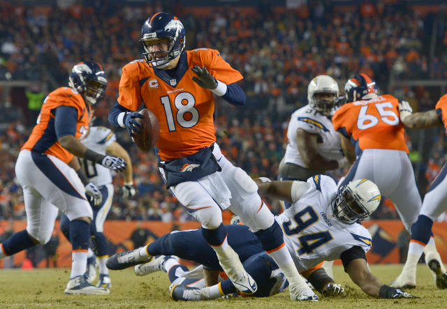 Denver Broncos quarterback Peyton Manning (18) rolls out of the pocket to escape from San Diego Chargers defensive end Corey Liuget (94) in the second quarter of an NFL football game, Thursday, Dec. 12, 2013, in Denver. Manning was sacked for a 12-yard loss on the play. (AP Photo/Jack Dempsey)