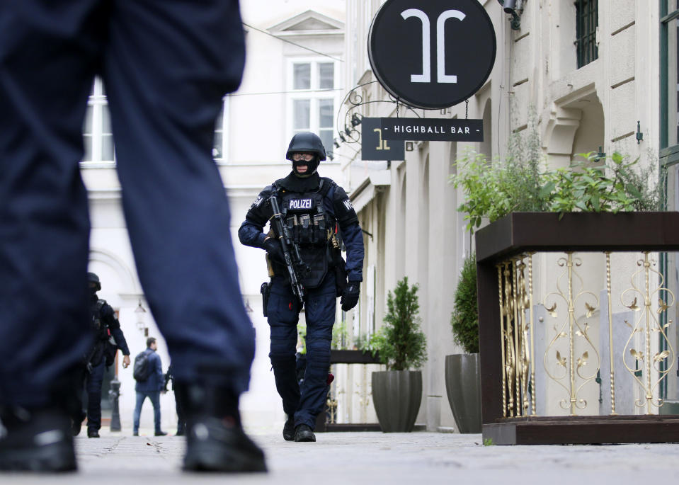 After a shooting an armed police officers patrols on a street at the scene in Vienna, Austria, Tuesday, Nov. 3, 2020. Police in the Austrian capital said several shots were fired shortly after 8 p.m. local time on Monday, Nov. 2, in a lively street in the city center of Vienna. Austria's top security official said authorities believe there were several gunmen involved and that a police operation was still ongoing. (Photo/Ronald Zak)