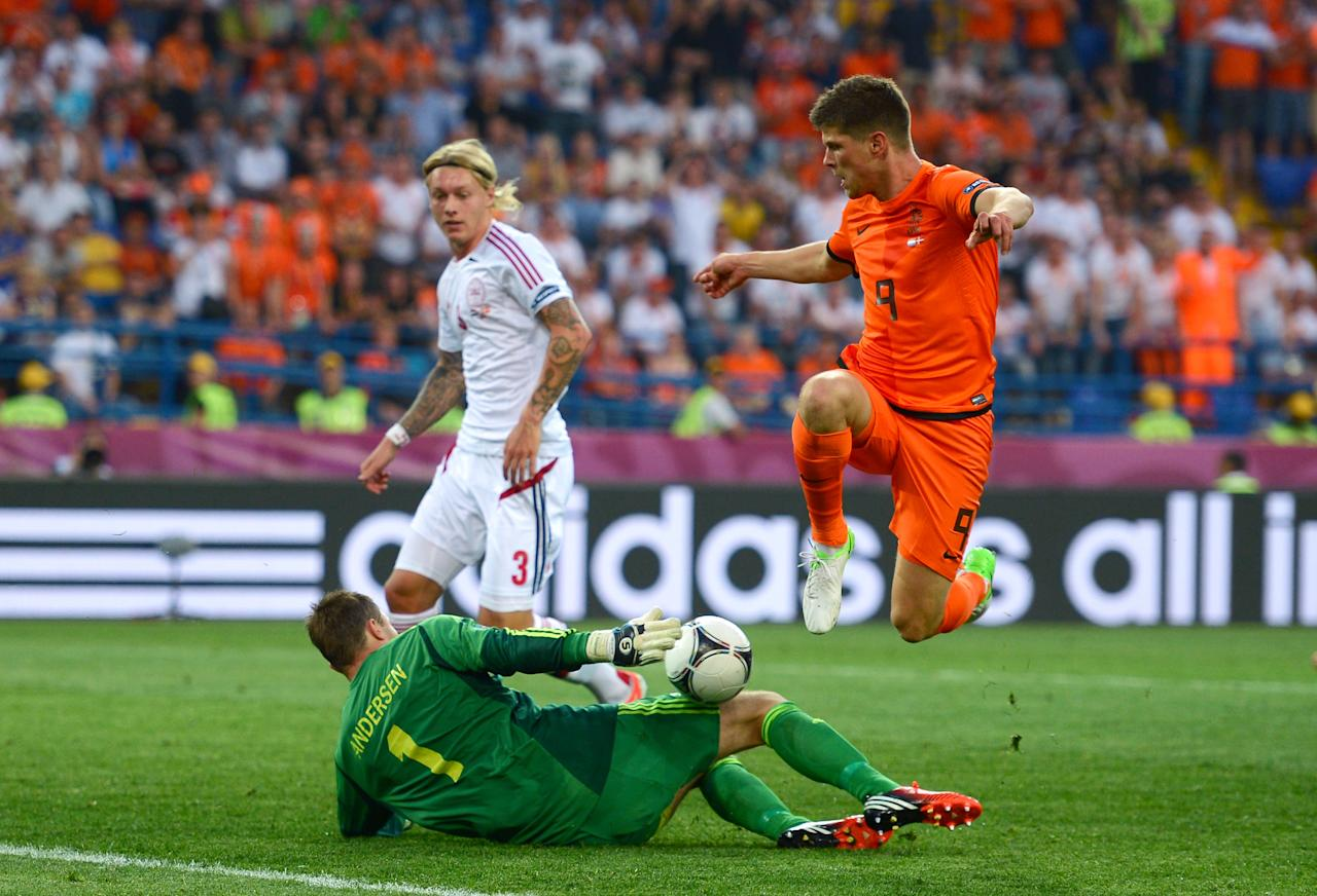 KHARKOV, UKRAINE - JUNE 09: Klaas Jan Huntelaar of Netherlands tries to chip the ball over goalkeeper Stephan Andersen of Denmark during the UEFA EURO 2012 group B match between Netherlands and Denmark at Metalist Stadium on June 9, 2012 in Kharkov, Ukraine.  (Photo by Lars Baron/Getty Images)