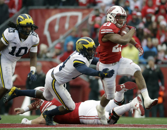 Wisconsin's Jonathan Taylor is third in the country in rushing. (AP Photo/Morry Gash, File)