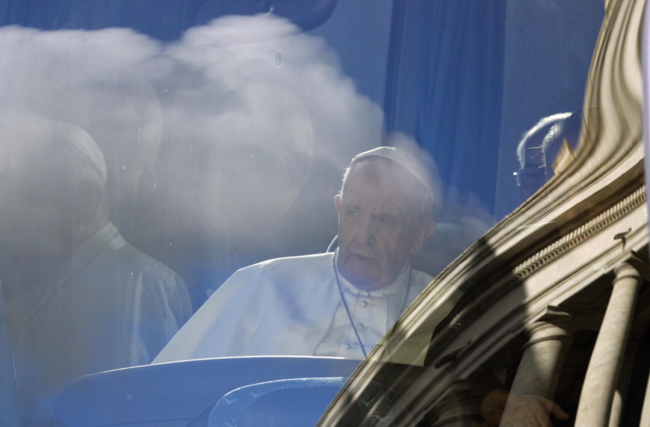 <p>Pope Francis sits on a bus as the Bernini colonnade is reflected on the windscreen, at the Vatican, March 5, 2017. Pope Francis has left for a week of spiritual retreat in the village of Ariccia. (Photo: Gregorio Borgia/AP) </p>