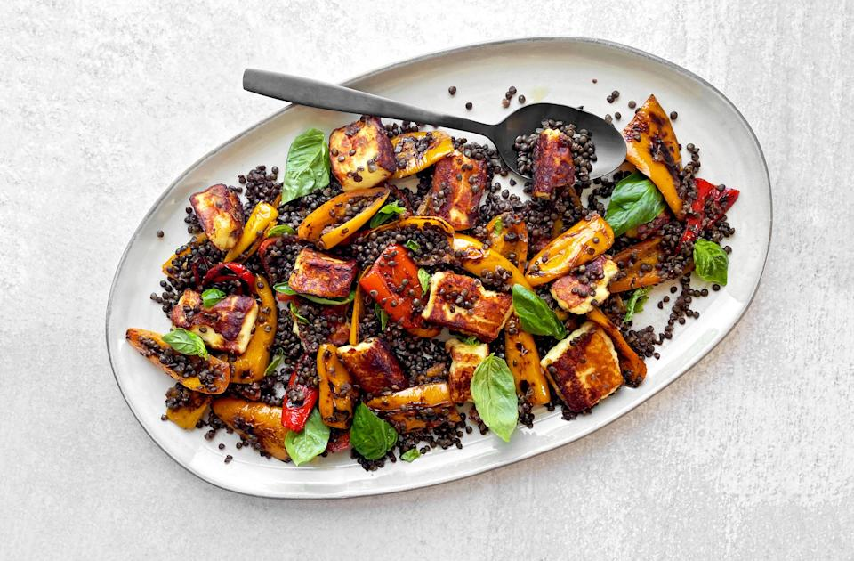 """This tasty salad is basically a vehicle for eating melty cheese, and it's one of our go-to summertime meals. Use a dense, grillable cheese (think Halloumi, paneer, or bread cheese), sear it to that perfect crispy texture, and combine with lentils. Top it all off with fresh basil for a bright, herby finish. <a href=""""https://www.epicurious.com/recipes/food/views/grilling-cheese-with-sweet-peppers-and-black-lentils-recipe?mbid=synd_yahoo_rss"""" rel=""""nofollow noopener"""" target=""""_blank"""" data-ylk=""""slk:See recipe."""" class=""""link rapid-noclick-resp"""">See recipe.</a>"""