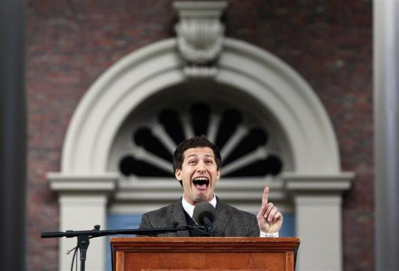 Comedian Andy Samberg gestures as he speaks during Harvard College Class Day at Harvard University in Cambridge, Massachusetts, May 23, 2012.