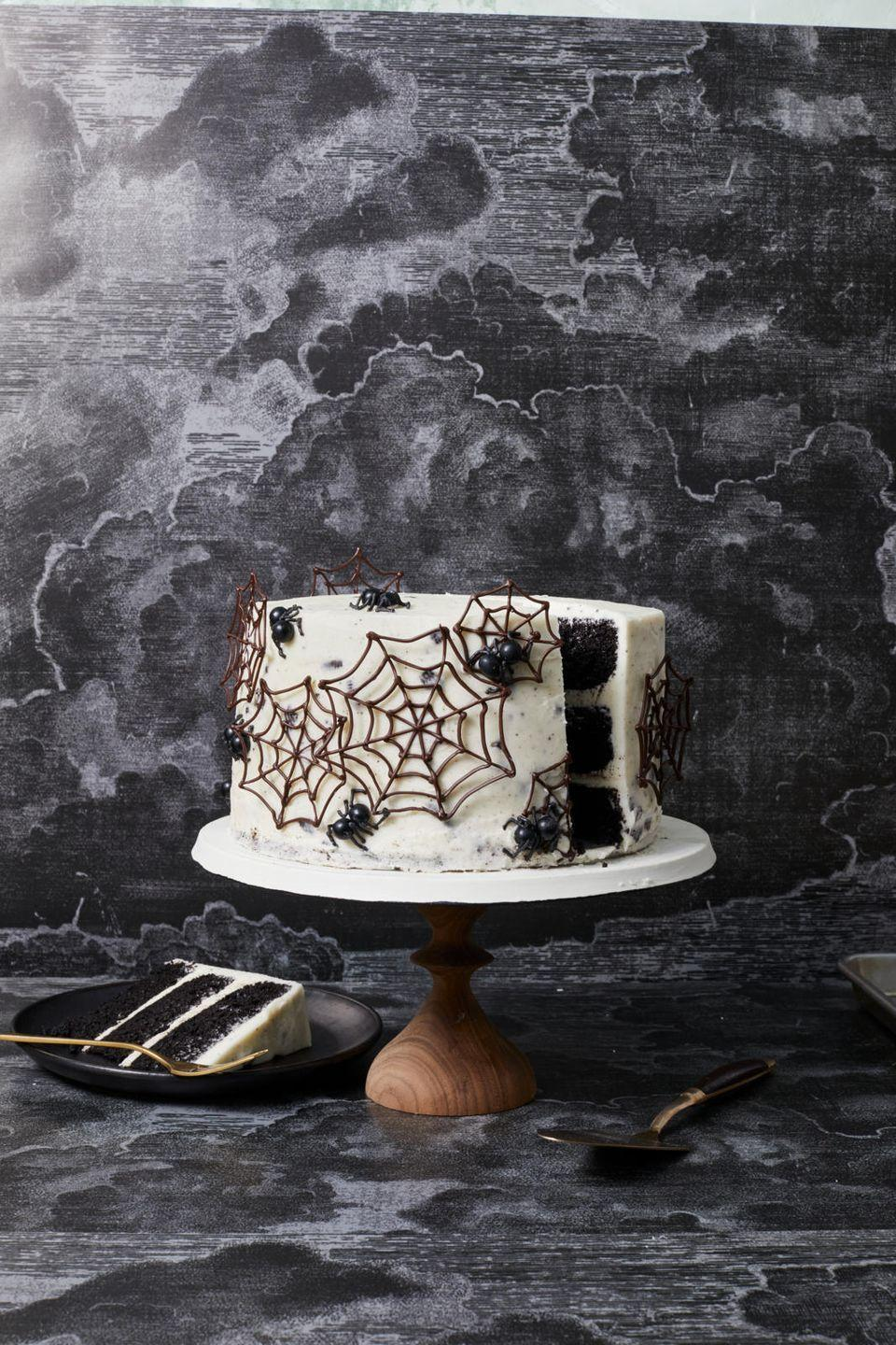 """<p>If you dare … try black cocoa powder for this spooky surprise-inside sweet with a crushed Oreo cookie frosting.</p><p><em><a href=""""https://www.goodhousekeeping.com/food-recipes/dessert/a33461174/spider-web-cake-recipe/"""" rel=""""nofollow noopener"""" target=""""_blank"""" data-ylk=""""slk:Get the recipe for Spider Web Cake »"""" class=""""link rapid-noclick-resp"""">Get the recipe for Spider Web Cake »</a></em></p>"""