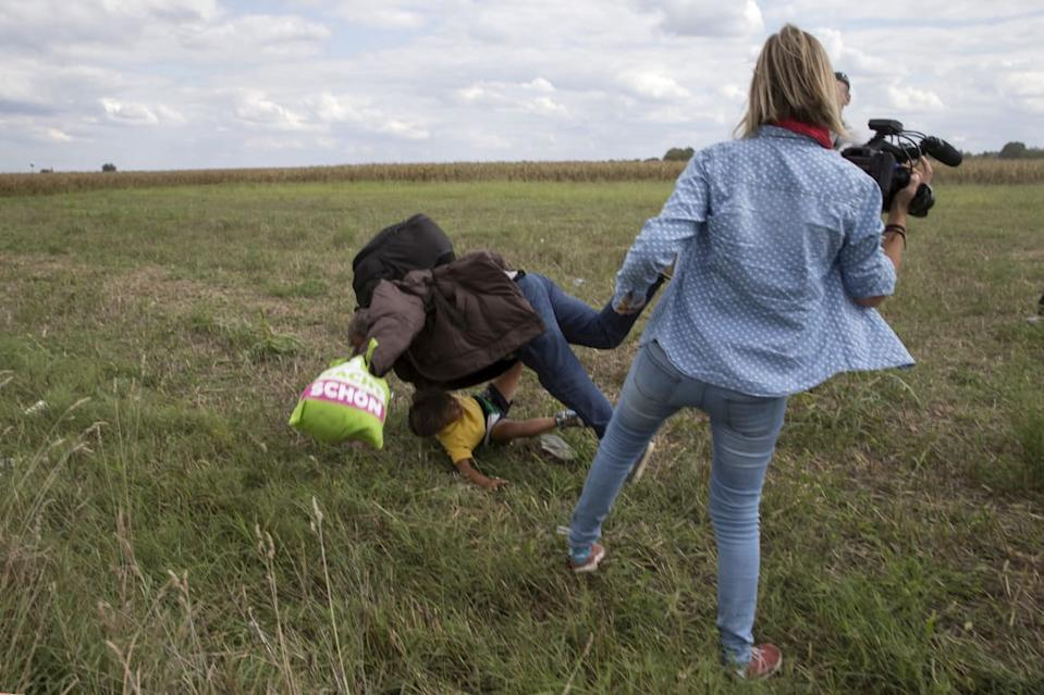 "<div class=""inline-image__caption""><p>A migrant carrying a child falls after tripping on TV camerawoman (R) Petra Laszlo while trying to escape from a collection point in Roszke village, Hungary, September 8, 2015.</p></div> <div class=""inline-image__credit"">Marko Djurica/Reuters</div>"