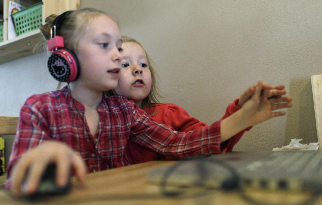Coy Mathis, right, plays on the computer at their home in Fountain, Colo., Monday Feb. 25, 2013. Coy has been diagnosed with Gender Identity Disorder. Biologically, Coy, 6, is a boy, but to his parents, three sisters and brother, family members and the world, Coy is a transgender girl. Ideas about gender-disorders began to develop in the 1950s, and have been evolving ever since, both within the medical community, and in American society. (AP Photo/Brennan Linsley)
