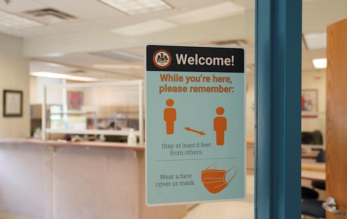 A sign of health safety measures to prevent the spread of the coronavirus disease (COVID-19) is seen on the door to the main office at Mantua Elementary School in Fairfax, Virginia, U.S., July 17, 2020.  (Kevin Lamarque/Reuters)