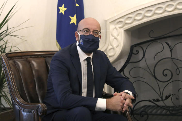 European Union Council President Charles Michel wears a face mask to prevent the spread of COVID-19 during a meeting with Cyprus President Nicos Anastasiades at the Presidential Palace in the capital Nicosia, Cyprus, on Wednesday, Sept.16, 2020. Michel is visiting Cyprus after travelling to Greece amid a diplomatic drive to de-escalate a weeks-long standoff at sea over Turkey's hydrocarbons search in waters were Greece and Cyprus claim exclusive economic rights. (Yiannis Kourtoglou, Pool via AP)