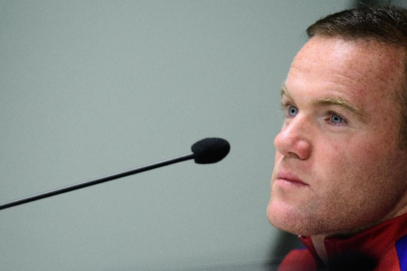 """England striker Wayne Rooney urged any player who had been affected by abuse to call a new hotline for victims and no longer """"suffer in silence"""" (AFP Photo/Jure Makovec)"""