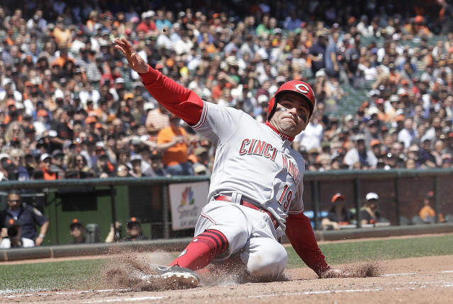 Cincinnati Reds' Joey Votto scores against the San Francisco Giants during the fifth inning of a baseball game in San Francisco, Wednesday, May 16, 2018. (AP Photo/Jeff Chiu)