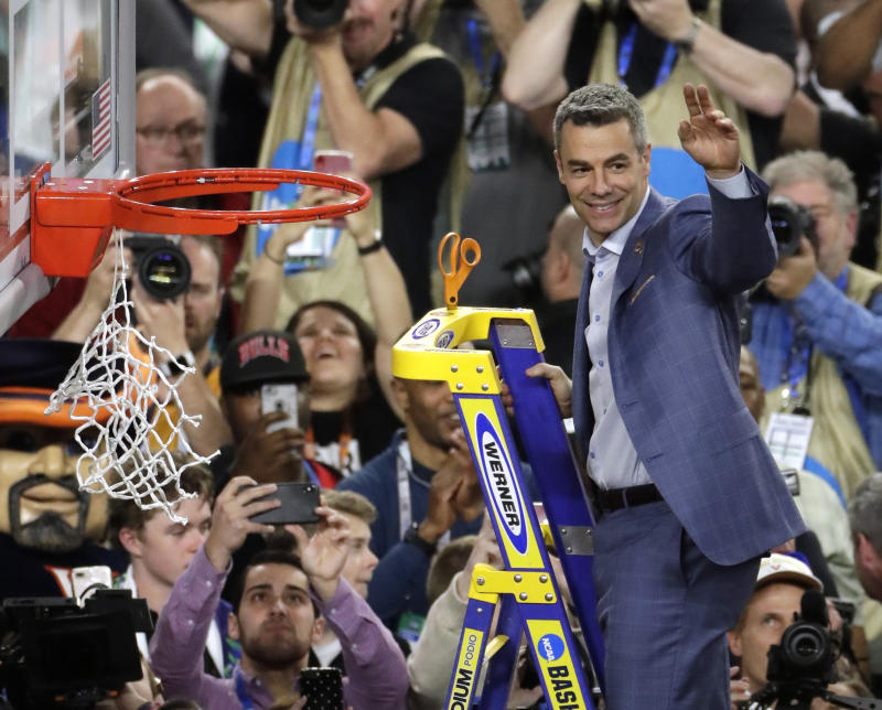Virginia head coach Tony Bennett cuts down the net following the championship game against Texas Tech in the Final Four NCAA college basketball tournament, Monday, April 8, 2019, in Minneapolis. Virginia won 85-77 in overtime. (AP Photo/Matt York)
