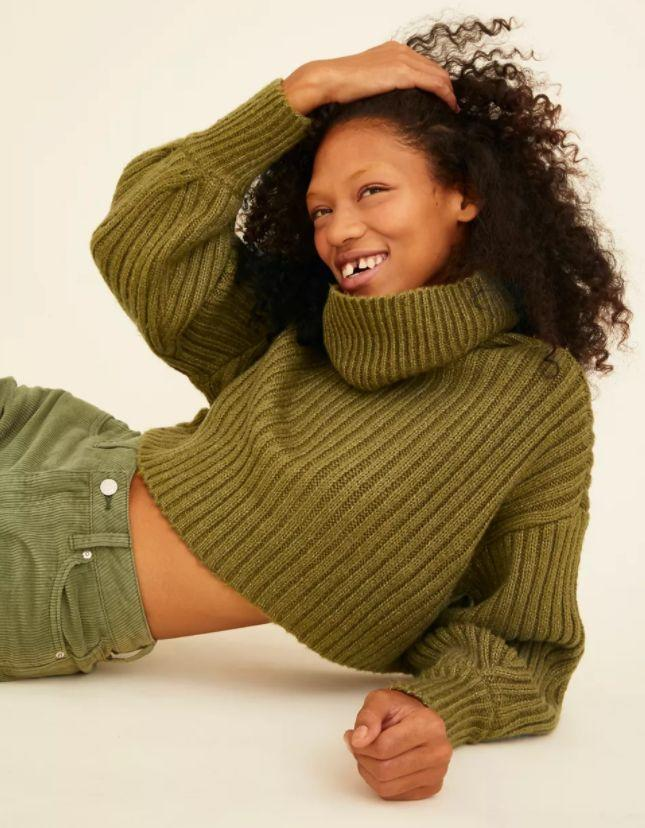 """""""I love the look of a cropped sweater with oversized sleeves, so when I spotted this <a href=""""https://fave.co/2VjBkWl"""" target=""""_blank"""" rel=""""noopener noreferrer"""">turtleneck on sale for half off at Urban Outfitters</a> — I ordered it in three colors. I know I'll get a lot of use out of it because I can pair with jeans and skirts for dressed up and dressed down looks."""" — Gonzalez"""