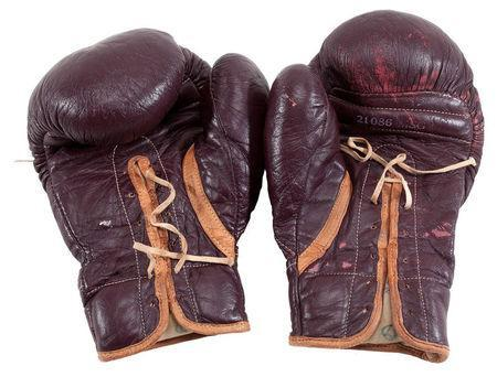 "Boxing gloves worn by Muhammad Ali during his March 8, 1971 ""Fight of the Century"" in Madison Square Garden against Joe Frazier are pictured in this undated handout photo obtained by Reuters July 11, 2016. Goldin Auctions/Handout via REUTERS"