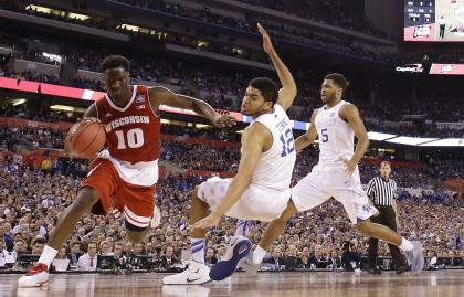 Nigel Hayes (10) drives against Kentucky's Karl-Anthony Towns (12) during the second half. (AP)