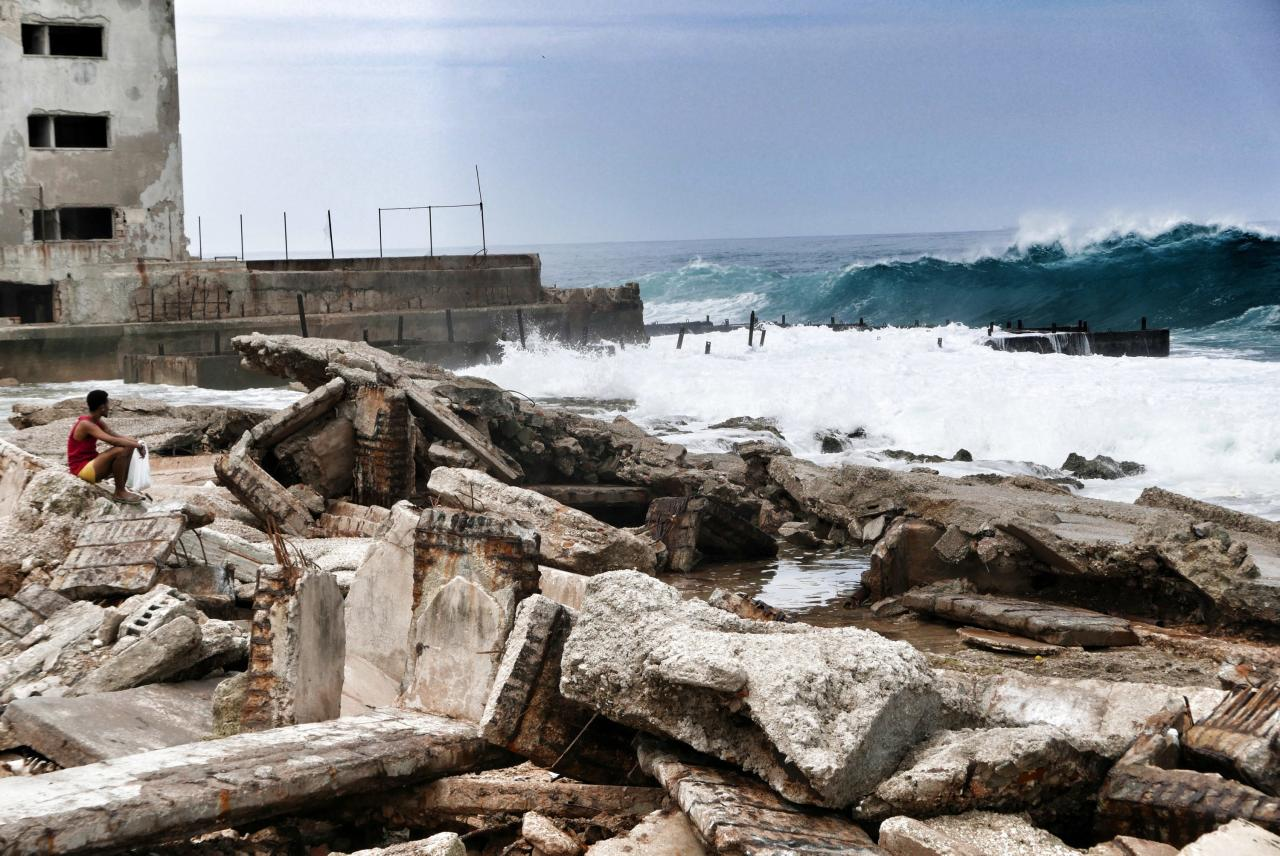 <p>A man looks out to the ocean three days after Hurricane Irma hit on Sept. 12, 2017 in Havana, Cuba. Hundreds of thousands still have no power as Cuba is recovering from the impact of Hurricane Irma. (Photo: Sven Creutzmann/Mambo photo/Getty Images) </p>