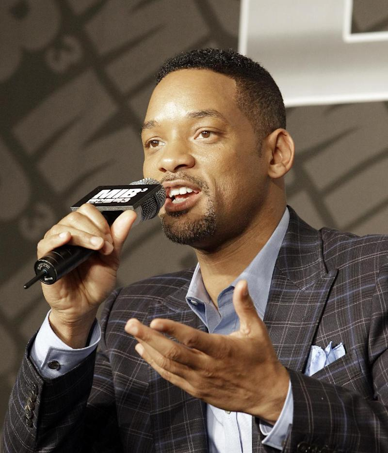 """Actor Will Smith answers a reporter's question during a press conference to promote his new movie """"Men in Black III"""" in Seoul, South Korea, Monday, May 7, 2012. (AP Photo/Lee Jin-man)"""