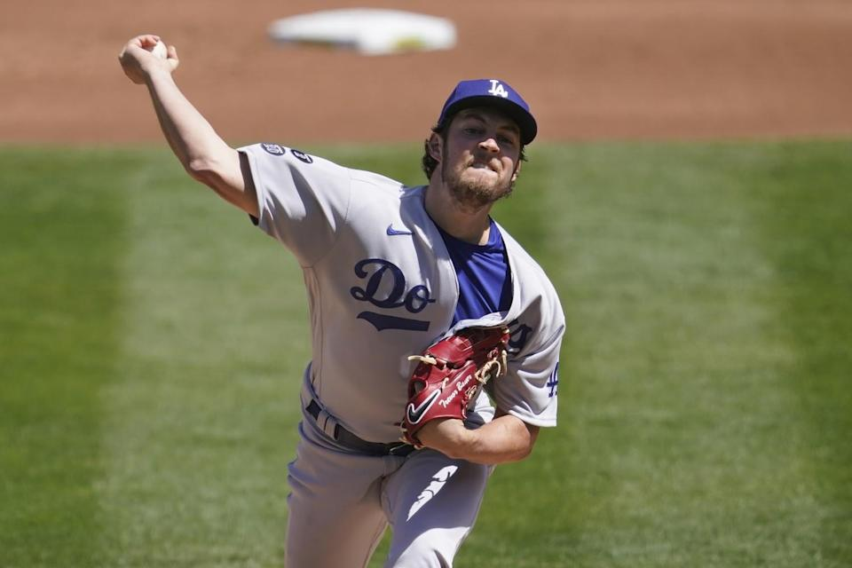 Dodgers pitcher Trevor Bauer throws against the Oakland Athletics.