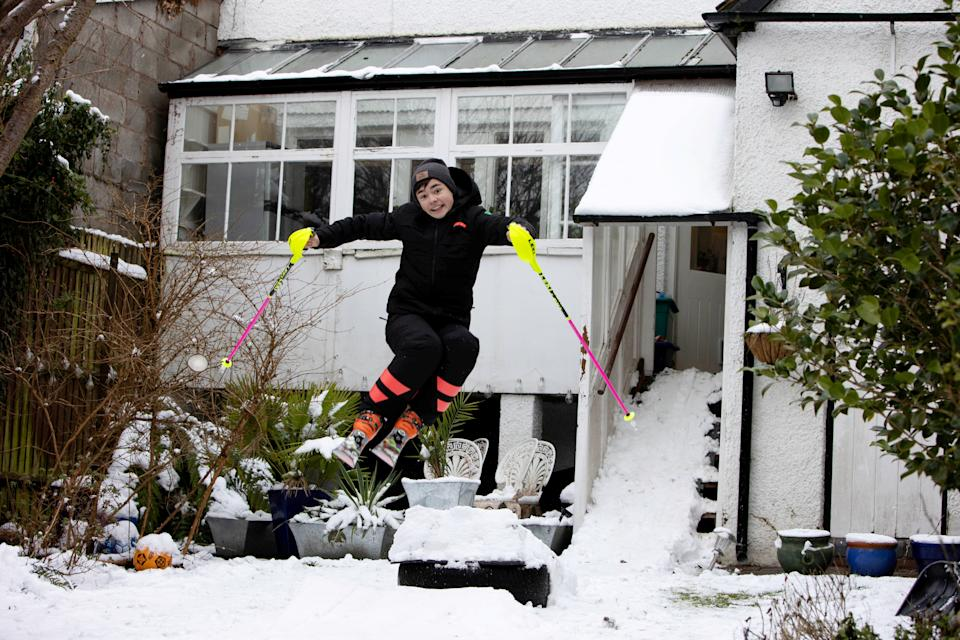 George Brown practicing ski jumping in his garden in Moseley, Birmingham. (SWNS)