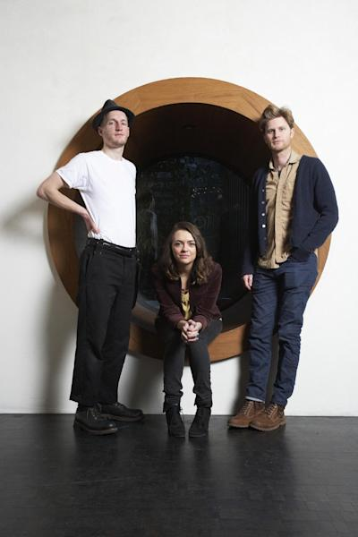 This Jan. 18, 2013 photo shows members of the American folk rock band The Lumineers, from left, Jeremiah Fraites, Neyla Pekarek and Wesley Schultz at the Dream Downtown Hotel in New York. The band is nominated for two Grammy Awards, including best new artist. The Grammys will be held on Feb. 10. (Photo by Dan Hallman/Invision/AP)