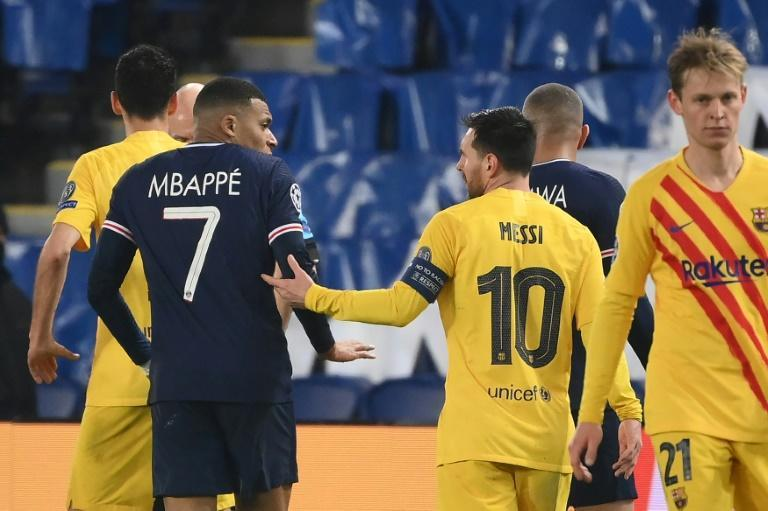 Mbappe and Messi together during the Champions League tie between PSG and Barcelona last season