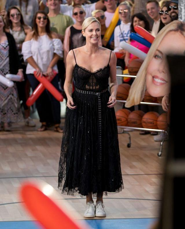 Theron plays basketball on <em>Jimmy Kimmel</em> in McQueen. (Photo: Getty Images)