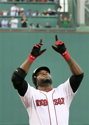 Boston Red Sox designated hitter David Ortiz gestures as he crosses the plate after hitting a two-run homer against the Miami Marlins in the first inning of an interleague baseball game at Fenway Park in Boston on Tuesday, June 19, 2012. (AP Photo/Elise Amendola)