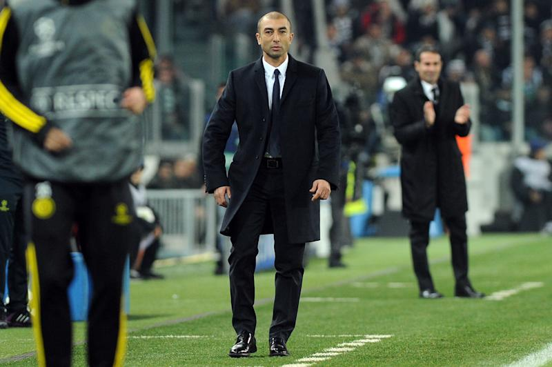 Chelsea' coach Roberto Di Matteo walks on the pitch during the Champions League, Group E, soccer match between Juventus and Chelsea at the Juventus stadium in Turin, Italy, Tuesday, Nov. 20, 2012. (AP Photo/Massimo Pinca)