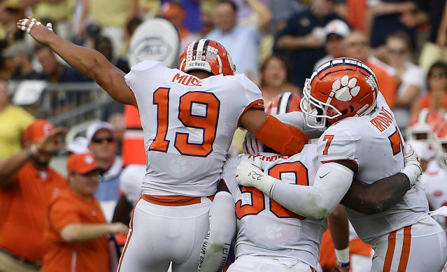 Clemson defensive end Clelin Ferrell (99) celebrates his touchdown against Georgia Tech with Clemson safety Tanner Muse (19) and Clemson defensive end Austin Bryant (7) during the first half of an NCAA college football game, Saturday, Sept. 22, 2018, in Atlanta. (AP Photo/Mike Stewart)