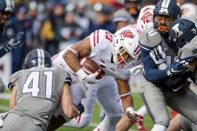 Illinois linebacker Jimmy Marchese (41) tackles Wisconsin running back Jonathan Taylor (23) during the first quarter of an NCAA college football game, Saturday, Oct. 28, 2017, at Memorial Stadium in Champaign, Ill. (AP Photo/Bradley Leeb)