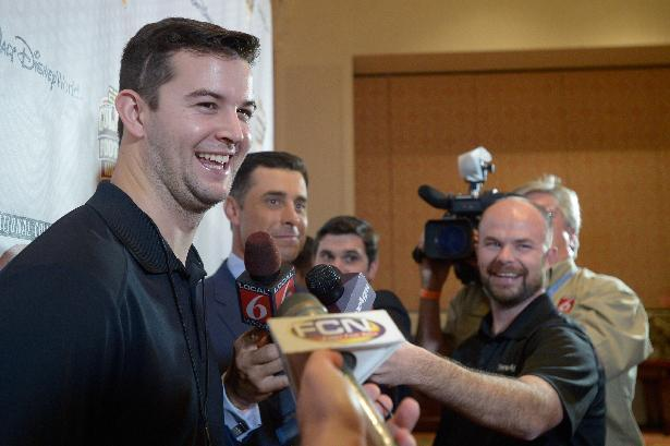 Alabama quarterback AJ McCarron, left, answers questions during a media availability prior to the College Football Awards show in Lake Buena Vista, Fla., Wednesday, Dec. 11, 2013. (AP Photo/Phelan M. Ebenhack)