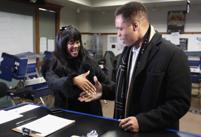 FILE - In this March 9, 2012 file photo, Rep. Jesse Jackson Jr. , D-Ill., and his wife, Chicago Alderman Sandi Jackson, ask each other for their support and votes as they arrive at a polling station for early voting in Chicago. On Friday, Feb. 15, 2013, Jackson, who resigned last year after nearly 17 years in office, was charged with spending $750,000 in campaign funds on personal expenses. His wife, Sandi, who resigned from the City Council in January 2013, was charged with filing false income tax forms. (AP Photo/M. Spencer Green, File)