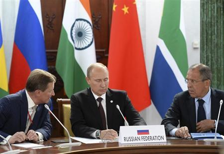 Russia's President Vladimir Putin, Foreign Minister Sergei Lavrov and Chief of Staff of the Presidential Administration Sergei Ivanov attend a BRICS leaders' meeting at the G20 Summit in Strelna near St. Petersburg
