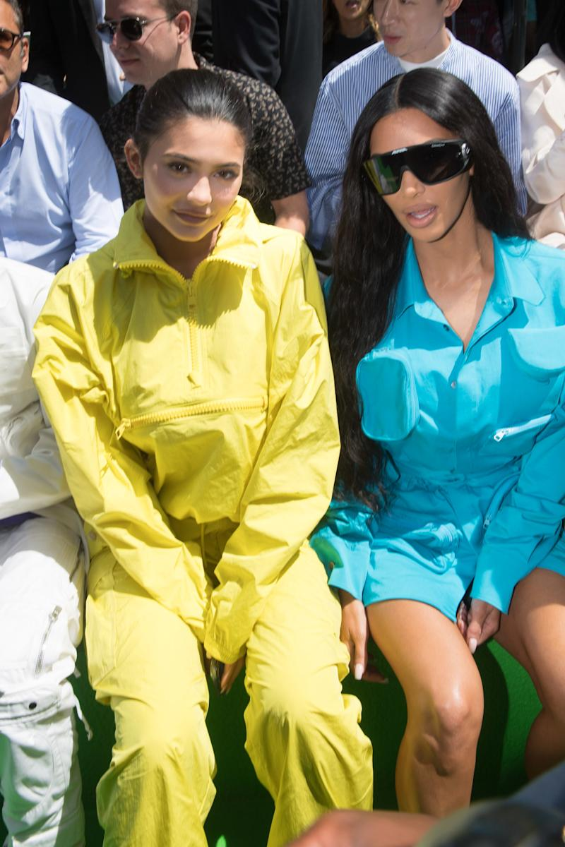 Kylie Jenner and Kim Kardashian attend the Louis Vuitton Menswear Spring/Summer 2019 show as part of Paris Fashion Week Week on June 21, 2018 in Paris, France. Photo courtesy of Getty Images.