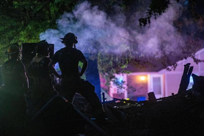 Raytown firefighters look over the scene after a duplex exploded in 7500 block of Englewood Avenue, Raytown, Monday, June 28, 2021 in Raytown, Mo. The cause of the fire is still under investigation.