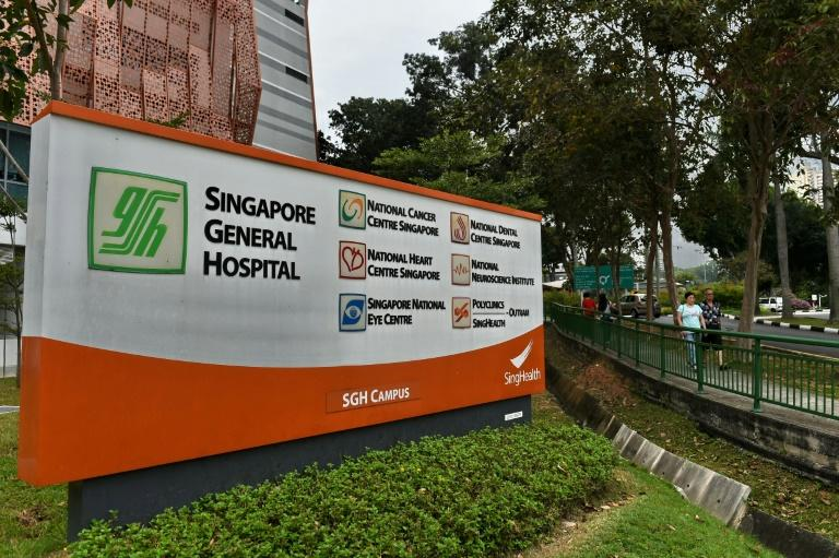 The state-run Singapore General Hospital said 678 patients as well as 273 medical workers were being contacted to be screened for the virus