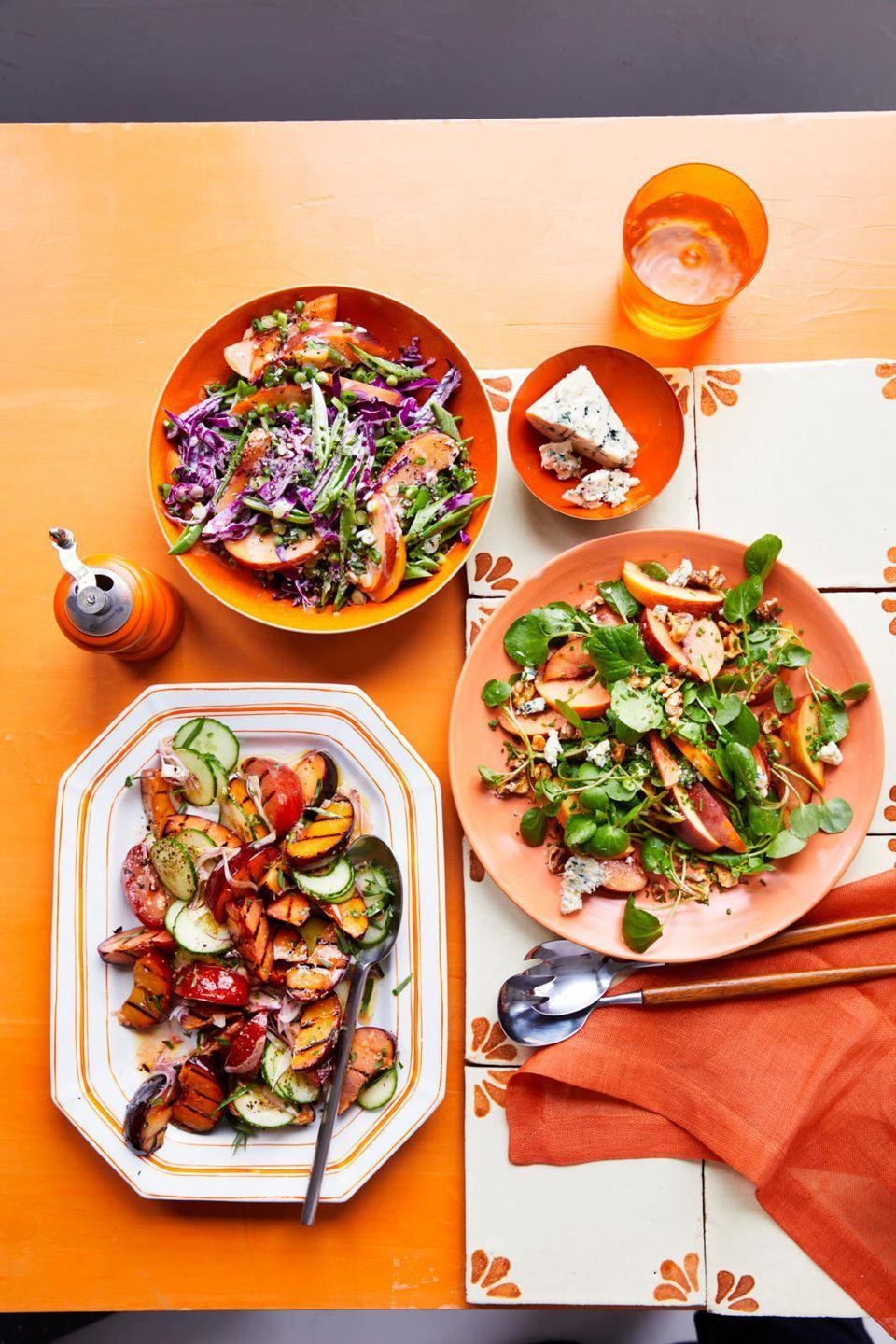 """<p>Throw summer fruit onto the BBQ and watch the grill works its magic. This cooking method amps up the caramelization of the plums' natural sugars (translation: the grill makes them sweeter and 10x more delicious). </p><p><em><a href=""""https://www.womansday.com/food-recipes/food-drinks/a22474606/gingery-grilled-stone-fruit-and-cucumber-salad-recipe/"""" rel=""""nofollow noopener"""" target=""""_blank"""" data-ylk=""""slk:Get the recipe for Gingery Grilled Stone Fruit and Cucumber Salad »"""" class=""""link rapid-noclick-resp"""">Get the recipe for Gingery Grilled Stone Fruit and Cucumber Salad »</a></em></p>"""